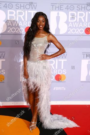 AJ Odudu poses for photographers upon arrival at the Brit Awards 2020 in London