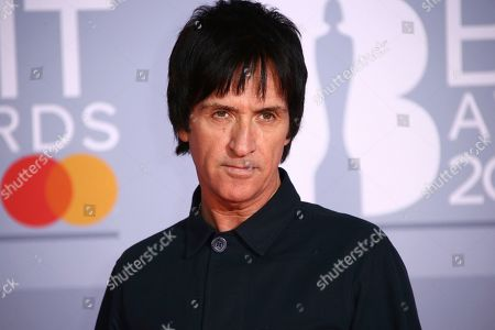 Stock Image of Johnny Marr poses for photographers upon arrival at the Brit Awards 2020 in London