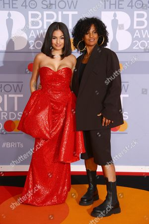 Mabel, Neneh Cherry. Mabel, left and Neneh Cherry pose for photographers upon arrival at the Brit Awards 2020 in London