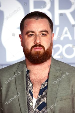 Tom Green poses for photographers upon arrival at the Brit Awards 2020 in London