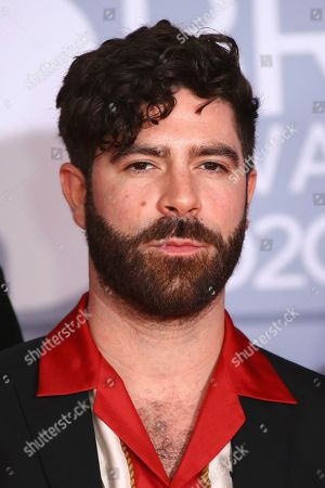 Foals lead singer Yannis Philippakis poses for photographers upon arrival at the Brit Awards 2020 in London