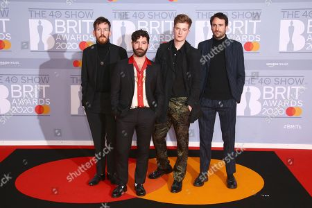 Yannis Philippakis, Jack Bevan, Jimmy Smith, Edwin Congreave. Edwin Congreave, Yannis Philippakis, Jack Bevan and Jimmy Smith of Foals pose for photographers upon arrival at the Brit Awards 2020 in London