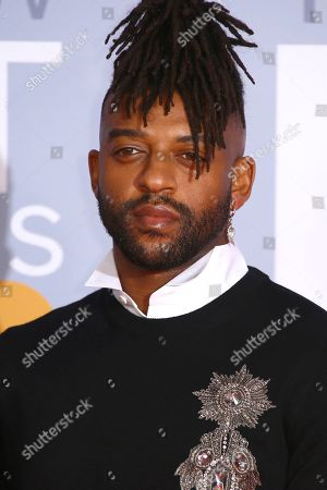Oritse Williams poses for photographers upon arrival at the Brit Awards 2020 in London
