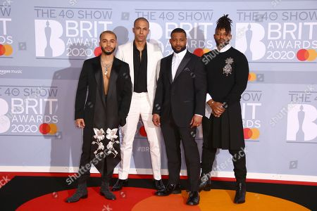Aston Merrygold, Marvin Humes, JB Gill, Oritse Williams. Aston Merrygold, Marvin Humes, JB Gill and Oritse Williams of JLS pose for photographers upon arrival at the Brit Awards 2020 in London