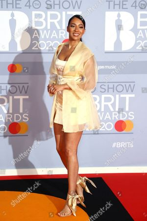 Yasmin Evans poses for photographers upon arrival at the Brit Awards 2020 in London