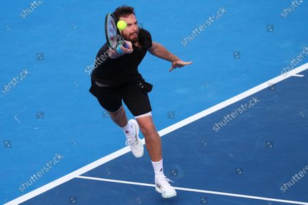 Ernests GULBIS (LAT) returns a serve during his match against Reilly OPELKA (USA) at the Delray Beach Open ATP professional tennis tournament, played at the Delray Beach Stadium & Tennis Center in Delray Beach, Florida, USA