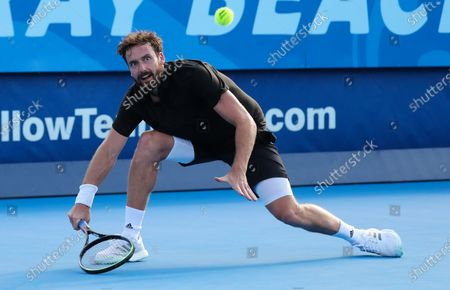 Ernests GULBIS (LAT) follows the ball after hitting a forehand against Reilly OPELKA (USA) at the Delray Beach Open ATP professional tennis tournament, played at the Delray Beach Stadium & Tennis Center in Delray Beach, Florida, USA