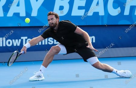 Ernests GULBIS (LAT) plays a forehand against Reilly OPELKA (USA) at the Delray Beach Open ATP professional tennis tournament, played at the Delray Beach Stadium & Tennis Center in Delray Beach, Florida, USA