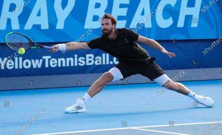 Ernests GULBIS (LAT) reaches out to play a forehand against Reilly OPELKA (USA) at the Delray Beach Open ATP professional tennis tournament, played at the Delray Beach Stadium & Tennis Center in Delray Beach, Florida, USA
