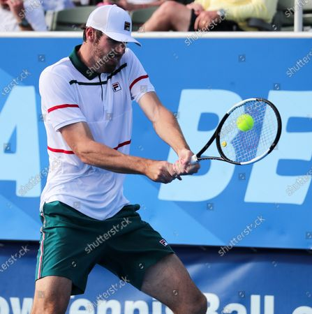 Stock Image of Reilly OPELKA (USA) returns a shot to Ernests GULBIS (LAT) at the Delray Beach Open ATP professional tennis tournament, played at the Delray Beach Stadium & Tennis Center in Delray Beach, Florida, USA