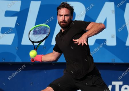Stock Picture of Ernests GULBIS (LAT) returns a forehand against Reilly OPELKA (USA) at the Delray Beach Open ATP professional tennis tournament, played at the Delray Beach Stadium & Tennis Center in Delray Beach, Florida, USA
