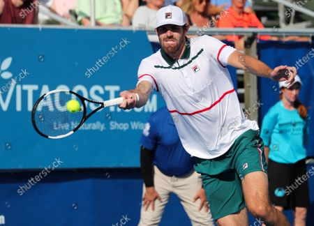 Reilly OPELKA (USA) hits a forehand against Ernests GULBIS (LAT) at the Delray Beach Open ATP professional tennis tournament, played at the Delray Beach Stadium & Tennis Center in Delray Beach, Florida, USA