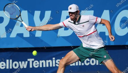 Stock Photo of Reilly OPELKA (USA) plays a forehand against Ernests GULBIS (LAT) at the Delray Beach Open ATP professional tennis tournament, played at the Delray Beach Stadium & Tennis Center in Delray Beach, Florida, USA