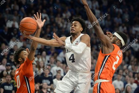 Stock Image of Penn State's Curtis Jones Jr. (4) splits Illinois defenders Alan Griffin (0) and Kipper Nichols (2) during the second half of an NCAA college basketball game, in State College, Pa