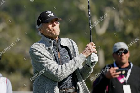 Clint Eastwood follows his shot from the 17th tee of the Pebble Beach Golf Links during the celebrity challenge event of the AT&T Pebble Beach National Pro-Am golf tournament, in Pebble Beach, Calif