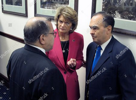 Stock Image of U.S. Sen. Lisa Murkowski speaks with state Sens. Lyman Hoffman, left, and Donny Olson, right, after she delivered an annual speech to a joint session of the Alaska Legislature, in Juneau, Alaska. Murkowski later told reporters that President Donald Trump has had policies that are good and have helped Alaska but did not say if she would support his re-election bid
