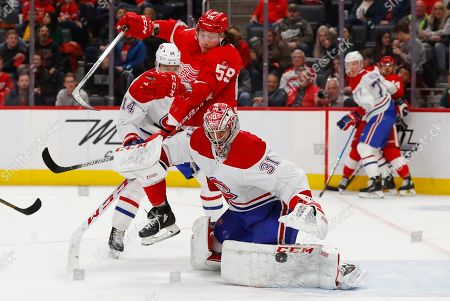 Montreal Canadiens goaltender Carey Price (31) deflects a shot as Detroit Red Wings left wing Tyler Bertuzzi (59) moves for the rebound during the second period of an NHL hockey game, in Detroit