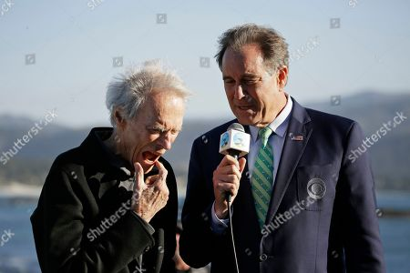Clint Eastwood, left, and Jim Nantz on the 18th green of the Pebble Beach Golf Links during the award ceremony of the AT&T Pebble Beach National Pro-Am golf tournament, in Pebble Beach, Calif