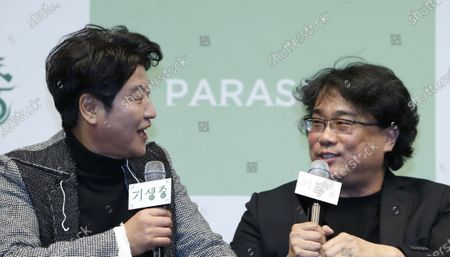 Song Kang-ho (L) and South Korean director Bong Joon-ho (R) speak during a press conference for the movie of Parasite in Seoul, South Korea, 19 February 2020. Parasite is the first foreign-language movie to win an Academy Award for Best Picture.