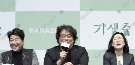 Bong Joon-ho (C), South Korean actor Song Kang-ho (L) and producer Kwak Sin-ae (R) smile during a press conference for the movie of Parasite in Seoul, South Korea, 19 February 2020. Parasite is the first foreign-language movie to win an Academy Award for Best Picture.