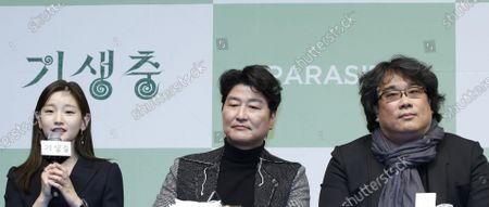 Stock Image of Park So-dam (L) Song Kang-ho (C) and South Korean director Bong Joon-ho (R) attend a press conference for the movie of Parasite in Seoul, South Korea, 19 February 2020. Parasite is the first foreign-language movie to win an Academy Award for Best Picture.