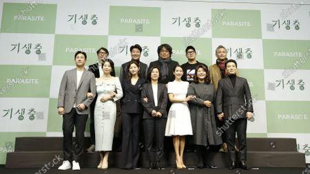 (Front L-R) South Korean actors Lee Sun-gyun,Jang Hye-jin, Park So-dam, producer Kwak Sin-ae, South Korean actors Cho Yeo-jeong, Lee Jung-eun, Park Myung-hoon, (back L-R) Editorial director Yang Jin-mo, South Korean actor Song Kang-ho, South Korean director Bong Joon-ho, screenwriter Han Jin-won, Art director Lee Ha-jun pose for photos during a press conference for the movie of Parasite in Seoul, South Korea, 19 February 2020. Parasite is the first foreign-language movie to win an Academy Award for Best Picture.