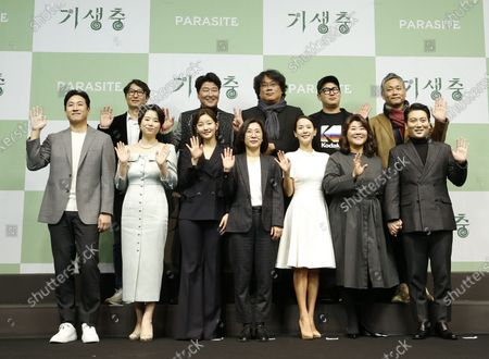 Stock Photo of (Front L-R) South Korean actors Lee Sun-gyun,Jang Hye-jin, Park So-dam, producer Kwak Sin-ae, South Korean actors Cho Yeo-jeong, Lee Jung-eun, Park Myung-hoon, (back L-R) Editorial director Yang Jin-mo, South Korean actor Song Kang-ho, South Korean director Bong Joon-ho, screenwriter Han Jin-won, Art director Lee Ha-jun pose for photos during a press conference for the movie of Parasite in Seoul, South Korea, 19 February 2020. Parasite is the first foreign-language movie to win an Academy Award for Best Picture.