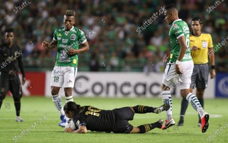 Leon's William Tesillo (R) and Pedro Aquino (L) in action against Los Angeles FC's Carlos Vela (C) during a CONCACAF Champions League round 16 match at the Nou Camp Stadium in Leon, Guanajuato, Mexico, 18 February 2020.