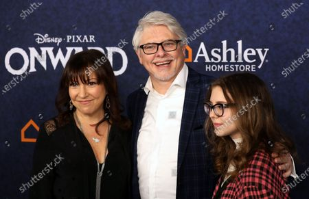 Dave Foley (C) and Actress Crissy Guerrero (L) arrives at the premiere of theDisney Pixar movie Onwardat El Capitan Theatre in Los Angeles, California, USA,18 February 2020.