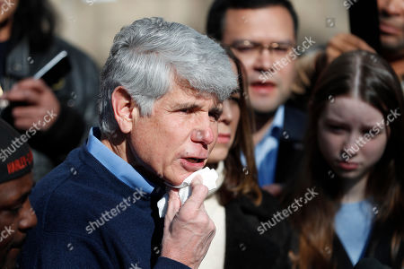 Former Illinois Gov. Rod Blagojevich keeps dabs blood from his chin during a news conference outside his home, in Chicago. On Tuesday, President Donald Trump commuted Blagojevich's 14-year prison sentence for political corruption. Blagojevich joked that it was the first time in a long time he has shaved with a normal razor