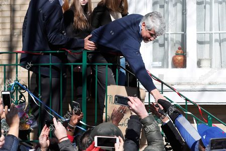 Former Illinois Gov. Rod Blagojevich shakes hands with supporters before a news conference outside his home, in Chicago. On Tuesday, President Donald Trump commuted Blagojevich's 14-year prison sentence for political corruption