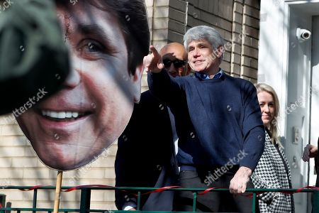 Former Illinois Gov. Rod Blagojevich points to supporters after a news conference outside his home, in Chicago. On Tuesday, President Donald Trump commuted Blagojevich's 14-year prison sentence for political corruption