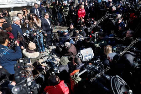 Former Illinois Gov. Rod Blagojevich, upper left, holds a news conference outside his home, in Chicago. On Tuesday, President Donald Trump commuted Blagojevich's 14-year prison sentence for political corruption