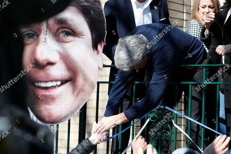 Former Illinois Gov. Rod Blagojevich shakes hands with supporters after a news conference outside his home, in Chicago. On Tuesday, President Donald Trump commuted Blagojevich's 14-year prison sentence for political corruption