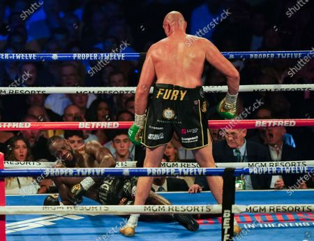 Tyson Fury   knocks  Deontay Wilder  down in the 3rd Round