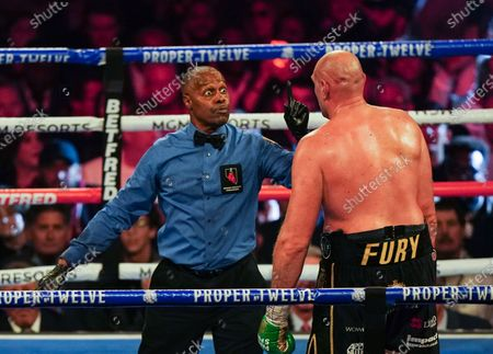 Referee Kenny Bayless  as Tyson Fury   is docked a point