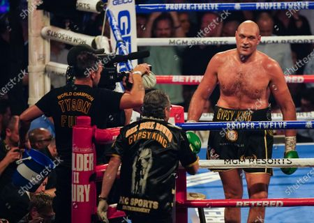 Tyson Fury   smiles to his corner after he knocks  Deontay Wilder  down in the 3rd Round