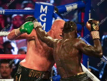 Stock Picture of Tyson Fury   beats  Deontay Wilder by TKO in 7th Round