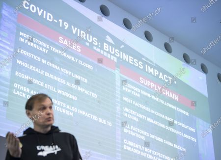 Bjorn Gulden, CEO of Puma, speaks in front of a sheet showing effects of Covid-19 Virus to the business of Puma during the annual earnings press conference in Herzogenaurach, Germany, 19 February 2020. The sporting goods manufacturer said they increased their sales in 2019 by 18.4 per cent to 5.502 million euros. The operating result (EBIT) improves by 30.5% from € 337 million to € 440 million according to the management.