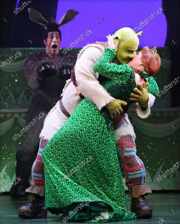Stock Photo of Lucy Durack as Princess Fiona (R), Ben Mingay as Shrek (C) and Nat Jobe as Donkey (L) perform during a media call for 'Shrek The Musical' at Her Majesty's Theatre in Melbourne, Victoria, Australia, 19 February 2020.