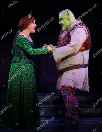 Australian actors, Lucy Durack as Princess Fiona (L) and Ben Mingay as Shrek perform during a media call for 'Shrek The Musical' at Her Majesty's Theatre in Melbourne, Victoria, Australia, 19 February 2020.