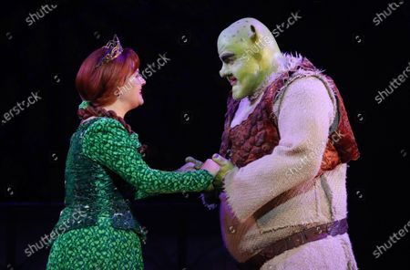 Stock Picture of Australian actors, Lucy Durack as Princess Fiona (L) and Ben Mingay as Shrek perform during a media call for 'Shrek The Musical' at Her Majesty's Theatre in Melbourne, Victoria, Australia, 19 February 2020.
