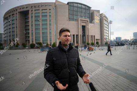 Amnesty International's Andrew Gardner speaks to the media outside the courthouse where the trial of the Amnesty International's former Turkey chairman and 10 other activists takes place, in Istanbul, Wednesday, Feb. 19. 2020. A court in Istanbul will hand down verdicts for defendants in the closely-watched trial on charges of belonging to or aiding terror groups. The case against activists heightened concerns about Turkey's treatment of human rights defenders
