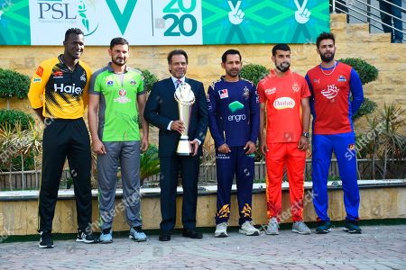 Pakistan's former squash world champion Jahangir Khan holds the PSL trophy along with captains of five participating teams (from left) Darren Sammy, Sohail Akhtar, Sarfaraz Ahmed, Shadab Khan and Imad Wasim at the National Stadium in Karachi, Pakistan, . Pakistan's premier domestic Twenty20 cricket league begins from Thursday with the final scheduled to be played at Lahore on March 22, 2020