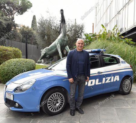 Luca Zingaretti with an Italian Police car