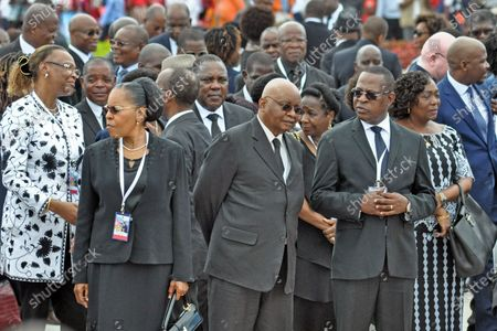 Stock Photo of Former President of the Republic of Mozambique Armando Guebuza (C) accompanied by his wife Maria da Luz Guebuza (2-L) attends to funeral ceremonies of Marcelino dos Santos, in Maputo, Mozambique, 19 February 2020. The State funeral of Marcelino dos Santos, one of the founders of the Mozambique Liberation Front (Frelimo), a party in power since independence, is being held today in Maputo, after seven days of national mourning.