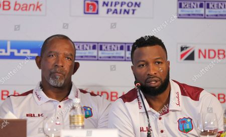 Stock Picture of West Indies' cricket captain Kieran Pollard, right, speaks to media as coach Phil Simmons watches during the inauguration of NDB series trophy in Colombo, Sri Lanka, . West Indies will play three one-day international and two Twenty20 matches beginning Feb. 22