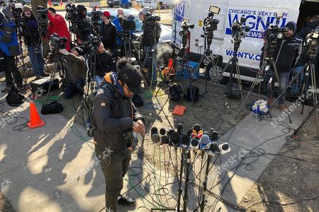 Members of the media prepare for a news conference with former Ill. Gov. Rod Blagojevich outside of his home, in Chicago. Blagojevich is back home in Chicago after his sentence for political corruption was commuted by President Donald Trump