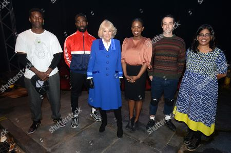 Camilla Duchess of Cornwall poses for a photo with the cast, crew and writer Antoinette Nwandu (3-R) of Kiln theatre production 'Pass Over' during a visit to the Kiln Theatre in Brent.