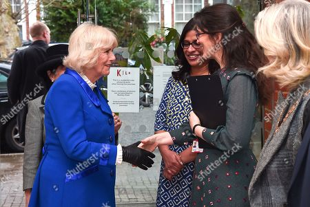 Camilla Duchess of Cornwall is greeted by Kiln Theatre Artistic Director, Indhu Rubasingham MBE and Executive Director of Kiln Theatre, Daisy Heath during a visit to the Kiln Theatre in Brent.